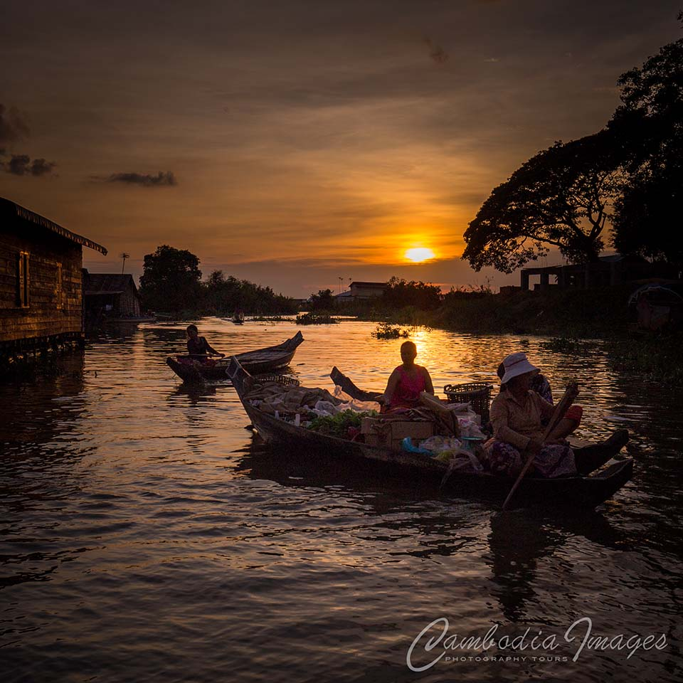floating village sunset cambodia